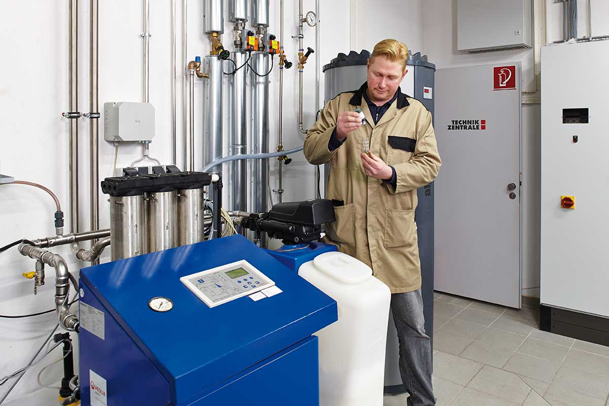 Employee tests the quality of the demineralised water